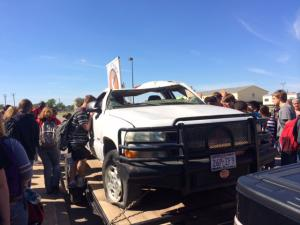 Students looking at Alex's truck after the program.