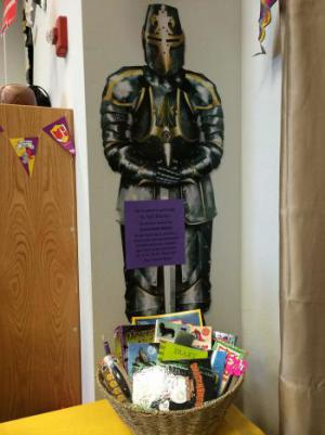Our brave knight, Sir Stiff Britches, standing guard over the Fall Family Raffle Basket.