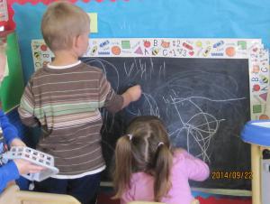 Ashtynn and Matthew perfecting their writing skills