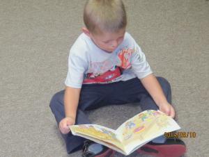 Matthew reading upside down, pretty tricky.