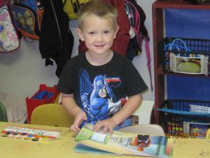 Noah reading his favorite book, Spiderman.