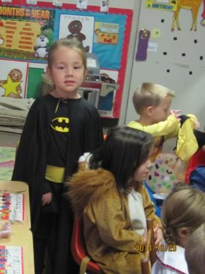 Batgirl Raelyn protecting our other super heros