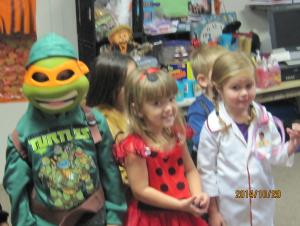 Ashtynn lady bug is playing with Dr, Kenzlee, and Andy, Ninja turtle.