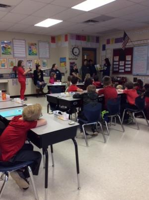 High School students reading to and answering questions about tobacco with our class