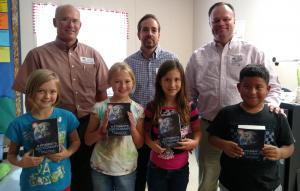 These 3rd graders are proud new owners of new dictionaries!