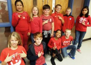 Mrs. Bells class is wearing their red for wear red day!