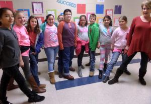 Mr. Wolf's class (and Mrs. T) show off their boots!