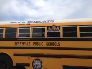 Mrs. Nance sticking her head out during the bus evacuation drill.  Is this proper bus safety?