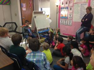 Fifth graders read to second graders