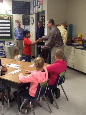 The Rotary Club handing out dictionaries in Mrs. Logan's class!
