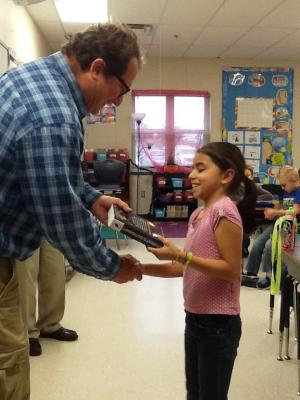 The Rotary Club handing out dictionaries to Mrs. Eddings' class.