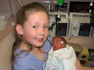 Blair holding Bradyn in Baptist NICU (December, 2006)