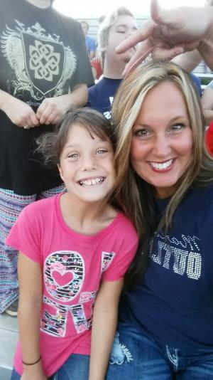 The first football game of her 3rd grade year. Miss her!!