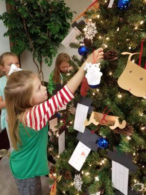 Decorating the bank Christmas tree