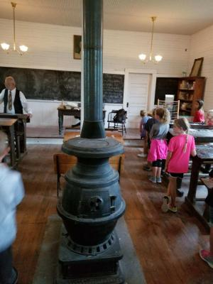 Standing by their desks - Harn Homestead