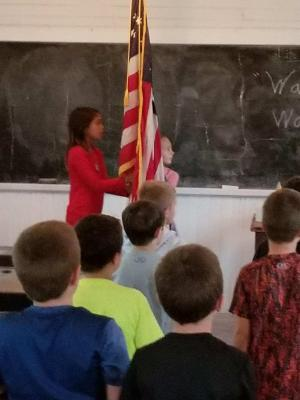 Saying the Pledge of Allegiance in the old school house - Harn Homestead