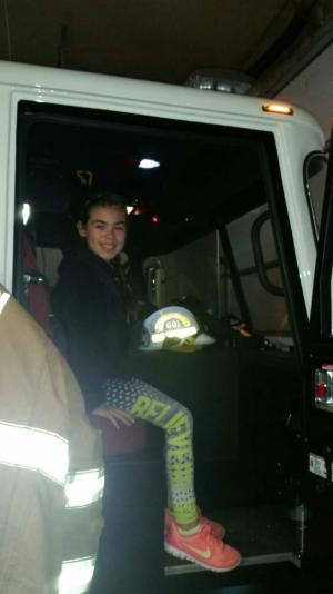 In the front of the firetruck