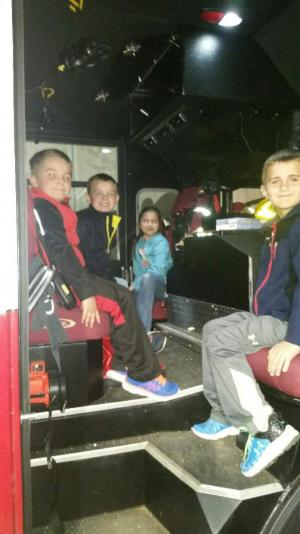 In the back of the firetruck