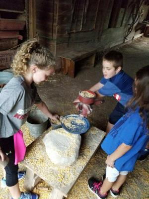 Making cornmeal at Harn Homestead