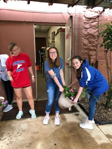 Student Council members planting flowers