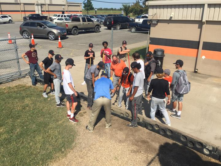 Baseball team doing playground work