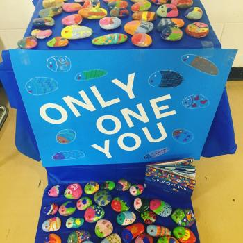 1st-3rd grade the book, Only One You then painted their own rocks like fish in the story. The story is about sharing wisdom from one generation to the other.