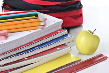 Photo of books, pencils, and misc. school supplies