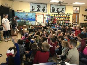 The high school visits our classroom as both first grade classes learn about traffic safety.