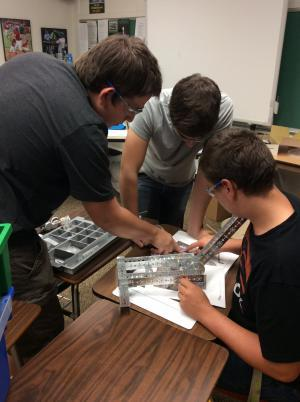 Nick, Mike and Tristan working on their engineering skills.