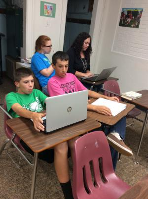 Hunter, Farah, Camden and Luke working on their programming skills.