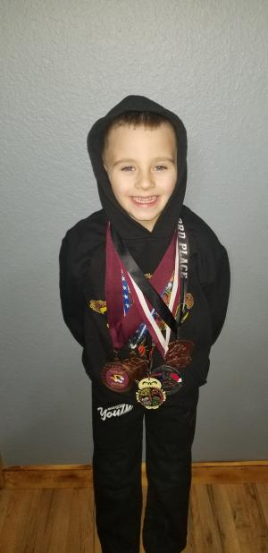 Jace Renfroe-His 1st year to wrestle. This is all the medals from this year. He won 1 First Place, 1 Second Place, 2 Third Place, 1 Fourth Place, Jace ended up 8th in State in the 49lbs Division!