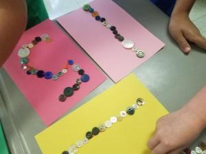 Students decorated the numbers we were working on with buttons.