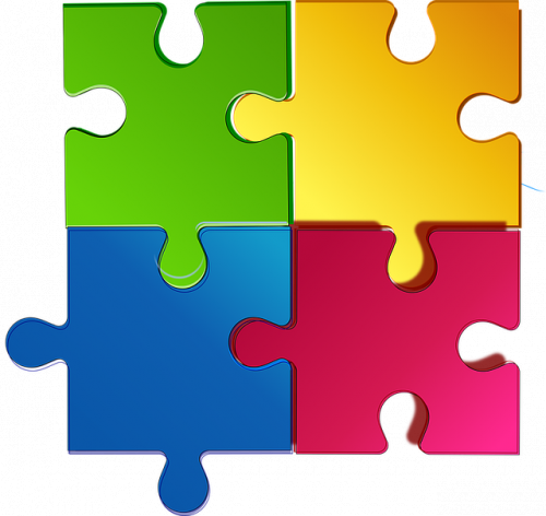 Four puzzles that are green, gold, blue and pink fitting together on a white background