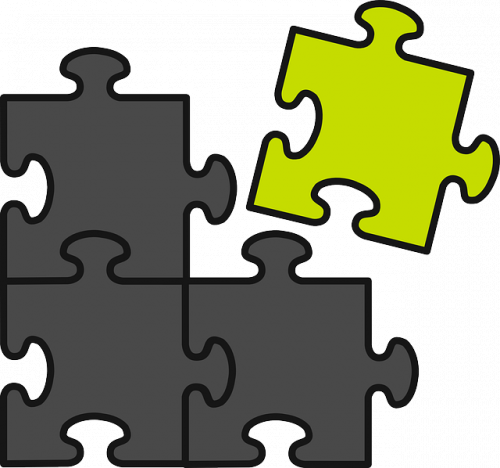 three black puzzles together with a yellow one to the upper right of the image on a white background