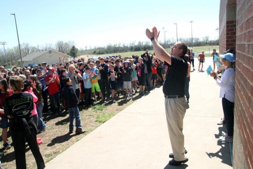 Principal Tim Hayden applauds award-winners with ACMS students.