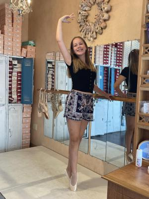 Grace loves dance and recently earned her Pointe shoes.