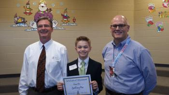 WES Spelling Bee winner, Ethan Ellis, standing with Andover Public Schools superintendent, Mr. Brett White, and Wheatland Elementary principal, Mr. Elton Armbrister.