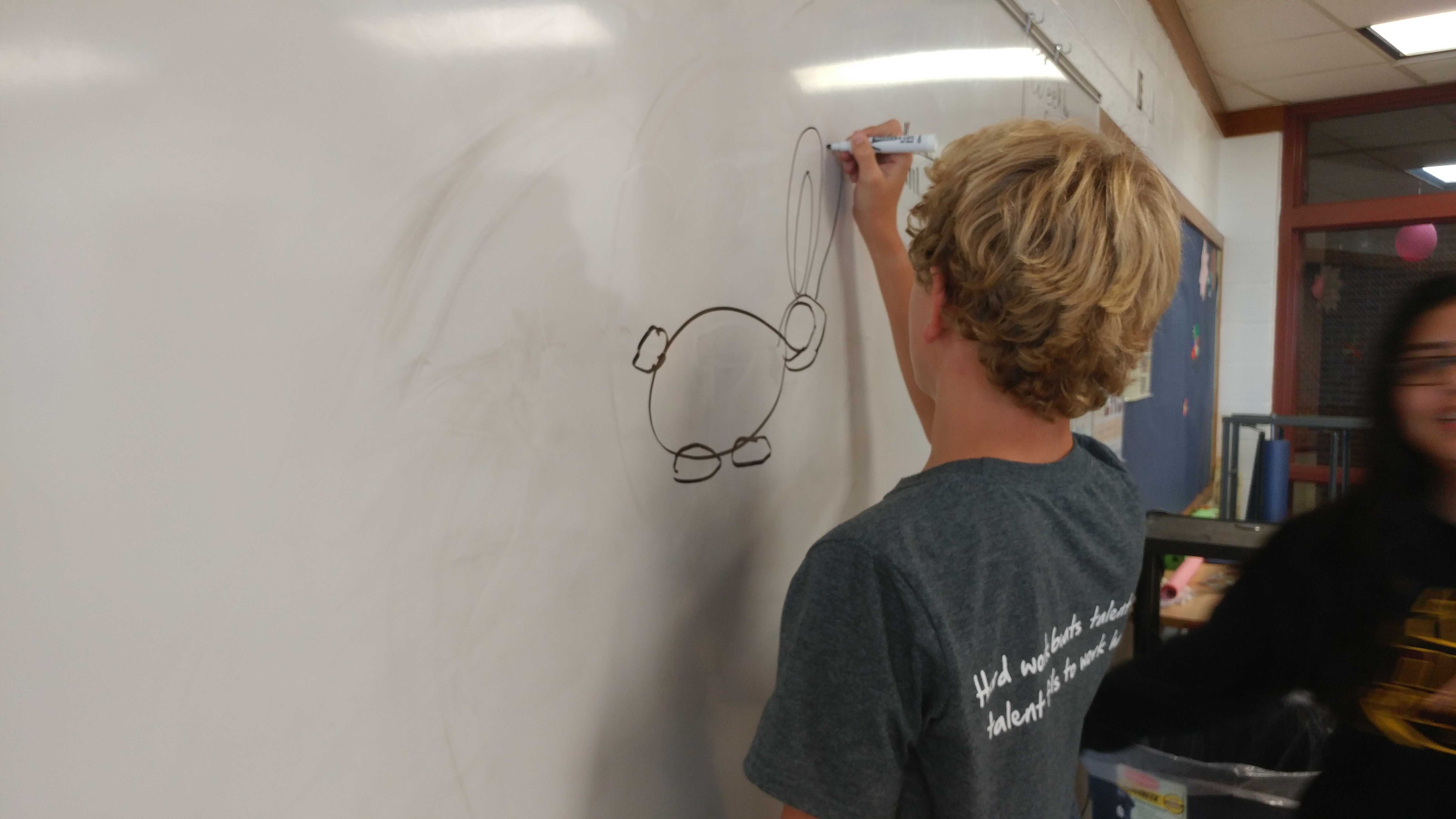 Ryan drawing a bunny for art pictionary