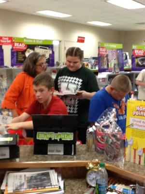 Mrs. Jackson helping students at the 1st Annual Book Fair