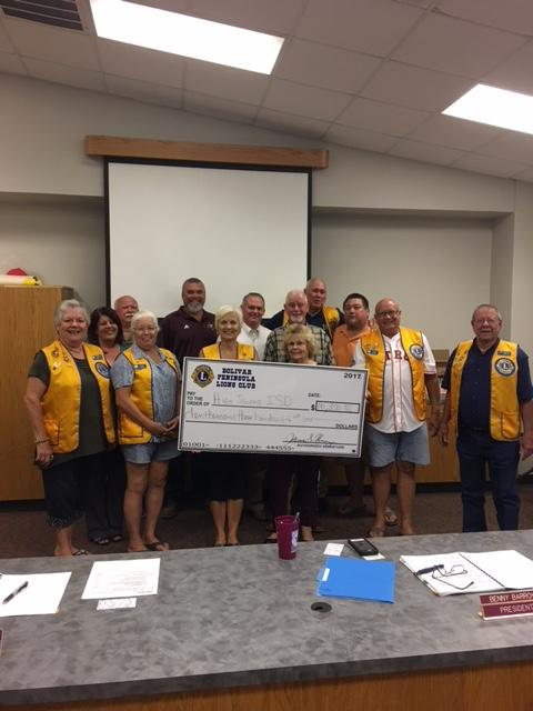 High Island ISD Board Members were presented with a check for $10,300 by The Bolivar Peninsula Lions Club