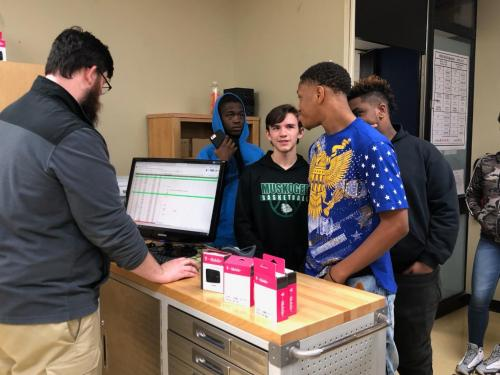 Students at Muskogee High School receive their T-Mobile WiFi Hotspots