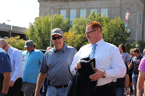 Mayor Bob Coburn (left) and Muskogee Public Schools Superintendent Dr. Jarod Mendenhall walk with others as part of WISH, Inc.'s Walk In Her Shoes on Thursday, Oct. 4, 2018