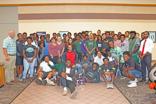 Students of Muskogee High School pose for a photo following Thursday's