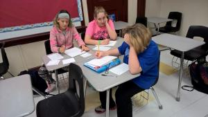 7th Graders working diligently on fraction cards