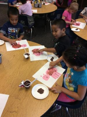 Painting mud with pudding.