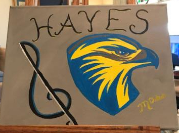 A painting of the Hayes Hawk logo and a treble clef.