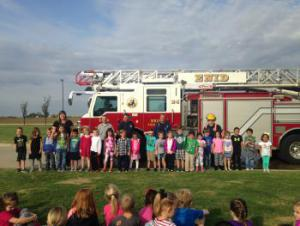 A visit from the Enid Fire Department!  John Cross came to talk to us about Fire Safety.  Then we were able to go outside and see the firetruck!  We LOVED watching them spray water!