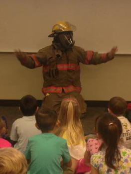 Mr. Cross showing us that firemen are not scary!