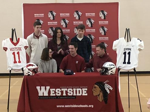 R Engle signing intent to play football