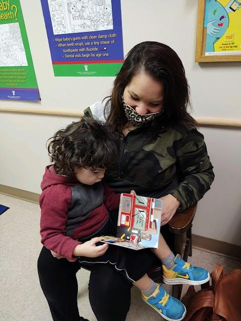 Turn a Page.Touch a Mind.® provides free books with well child visits